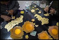 Gossamer-thin pieces of gold cut in squares, gold leaf workshop. Mandalay, Myanmar ( color)