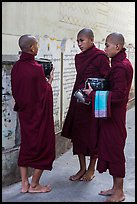 Three monks conversing at Mahagandayon Monastery. Amarapura, Myanmar ( color)