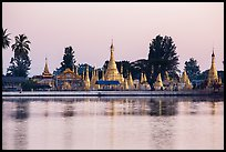 Pagoda reflected in Pone Tanoke Lake at dawn. Pindaya, Myanmar ( color)