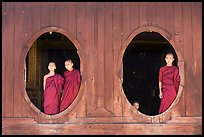 Monks standing in oval windows, Shweyanpyay Monastery, Nyaung Shwe. Inle Lake, Myanmar ( color)