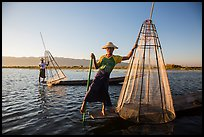 Intha fishermen with conical baskets in warm afternoon light. Inle Lake, Myanmar ( color)