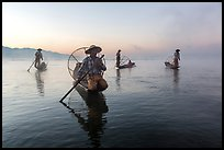 Group of Intha fishermen at dawn with surface mist. Inle Lake, Myanmar ( color)