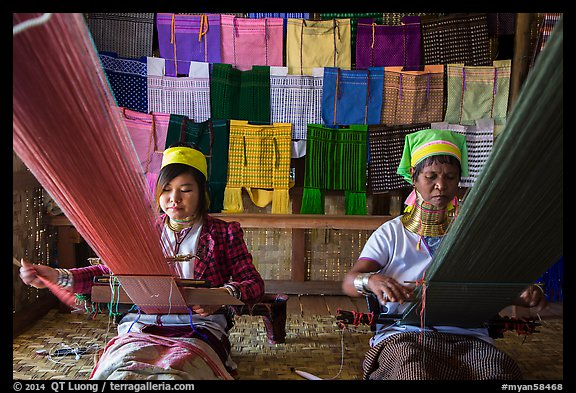 Weaving workshop with Kayan women of the Padaung tribe. Inle Lake, Myanmar (color)