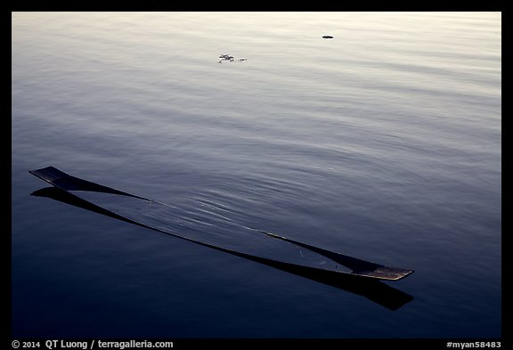 Sunken canoe and rippled water. Inle Lake, Myanmar (color)