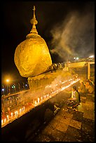Offerings to the Buddha continues throughout the night at the Golden Rock. Kyaiktiyo, Myanmar ( color)