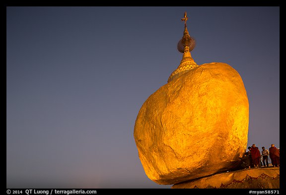 Golden Rock balancing boulder stupa and monks at dawn. Kyaiktiyo, Myanmar (color)