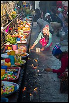 Morning food offering and pilgrims with cold weather hats. Kyaiktiyo, Myanmar ( color)