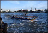 Crowded long tail taxi boat on Chao Phraya river. Bangkok, Thailand (color)