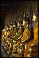 Row of Buddha statues in gallery, Wat Arun. Bangkok, Thailand ( color)