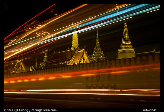 Wat Phra Kaew seen through the lights of traffic. Bangkok, Thailand (color)