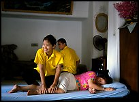 Traditional thai massage in traditional Thai medicine center of Wat Pho. Bangkok, Thailand (color)