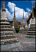 Layered and streamlined chedis in Ratanakosin style, Wat Pho. Bangkok, Thailand