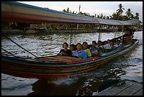 Evening commute, long tail taxi boat on canal. Bangkok, Thailand