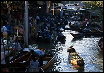 Woman paddling, floating market. Damonoen Saduak, Thailand (color)
