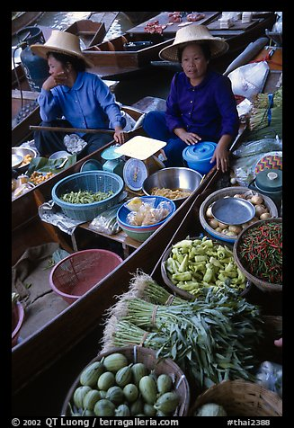 Women selling fruits and vegetables, Floating market. Damnoen Saduak, Thailand (color)