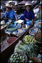 Women selling fruits and vegetables, Floating market. Damonoen Saduak, Thailand (color)
