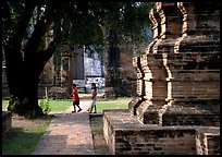 Children walk among ruins of the King Narai's palace. Lopburi, Thailand (color)
