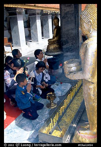 Worshipers at Wat Phra That Doi Suthep, the North most sacred temple. Chiang Mai, Thailand (color)