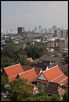 Temple rooftop and modern skyline. Bangkok, Thailand