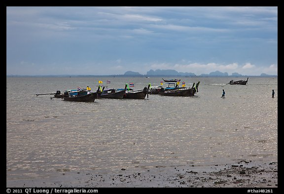 Boats anchored at low tide, storm sky,  Railay East. Krabi Province, Thailand (color)