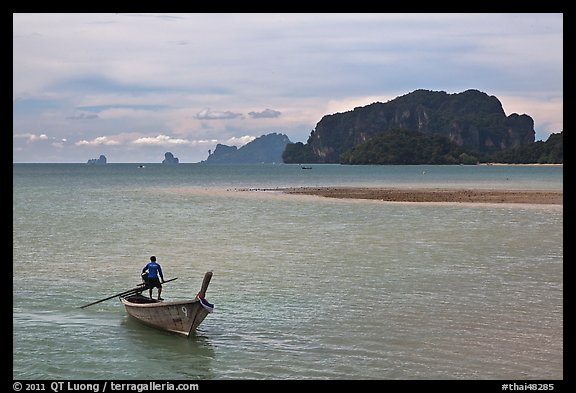 Man driving long tail boat, Ao Nammao. Krabi Province, Thailand (color)