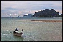 Man driving long tail boat, Ao Nammao. Krabi Province, Thailand ( color)