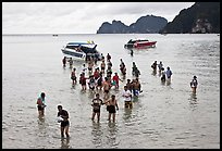 Asian tourists wading in water, Ko Phi Phi. Krabi Province, Thailand ( color)
