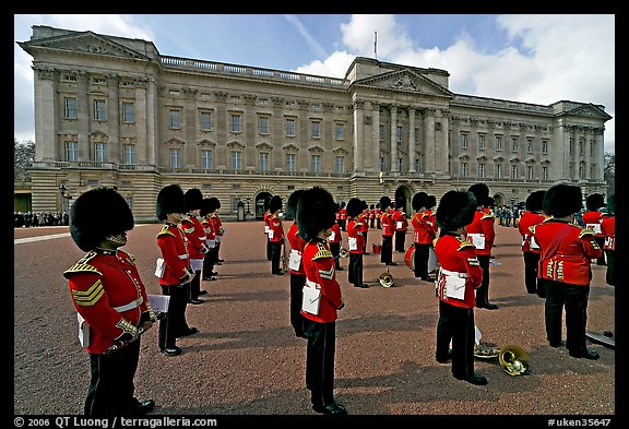 Rows of guards  wearing bearskin hats and red uniforms. London, England, United Kingdom (color)