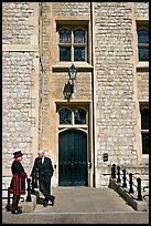 Yeoman Warder talking with man in suit in front of the Jewel House, Tower of London. London, England, United Kingdom ( color)