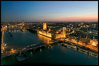 Aerial view of Thames River, Westmister Bridge and Palace at dusk. London, England, United Kingdom