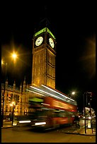 Big Ben and double decker bus in motion at nite. London, England, United Kingdom (color)