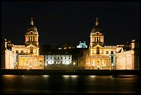 Old Royal Naval College, Queen's house, and Royal observatory with laser marking the Prime meridian at night. Greenwich, London, England, United Kingdom