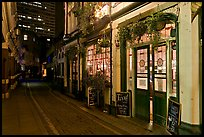 Saloon bar and cobblestone alley at night. London, England, United Kingdom ( color)