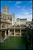 Great Bath Roman building, with Abbey in background. Bath, Somerset, England, United Kingdom