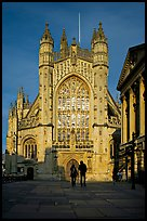 West facade of Bath Abbey with couple silhouette, late afternoon. Bath, Somerset, England, United Kingdom