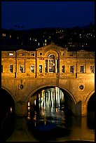 Central section of Pulteney Bridge, covered by shops,  at night. Bath, Somerset, England, United Kingdom