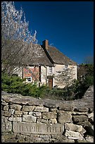 Stone wall with engraved street name, yard and house, Lacock. Wiltshire, England, United Kingdom ( color)
