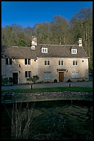 Cotswold type houses and Bybrook River, Castle Combe. Wiltshire, England, United Kingdom ( color)