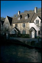 Cotswold type cottages and Bybrook River, Castle Combe. Wiltshire, England, United Kingdom ( color)
