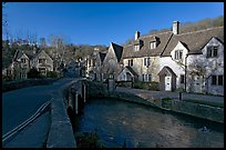 Main village street and Bybrook River, late afternoon, Castle Combe. Wiltshire, England, United Kingdom