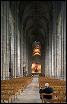 Man sitting in the Nave of the Canterbury Cathedral. Canterbury,  Kent, England, United Kingdom