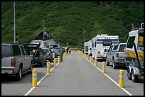 Cars and RVs lining up for the tunnel crossing. Whittier, Alaska, USA ( color)