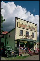 Ma Johnson hotel with classic car parked by, afternoon. McCarthy, Alaska, USA ( color)