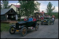 Classic cars driven on main street. McCarthy, Alaska, USA ( color)