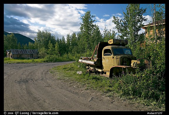 Side street with wrecked truck. McCarthy, Alaska, USA (color)