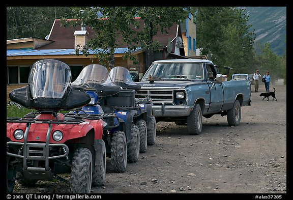 Four wheelers parked on main street. McCarthy, Alaska, USA (color)