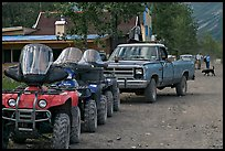 Four wheelers parked on main street. McCarthy, Alaska, USA ( color)