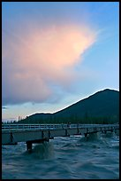Footbridge with the Kennicott River swelled from the annual Hidden Lake flood. McCarthy, Alaska, USA ( color)