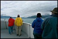 Passengers standing on deck with colorful  clothes. Seward, Alaska, USA