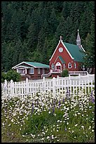 White flowers,  picket fence, red church, and forest. Seward, Alaska, USA (color)